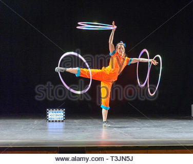Edinburgh, UK. 10th April, 2019. Engineer Aoife Raleigh  demonstrates her hula hoop skills during the photo call for StrongWomen Science abrand-new circus science showat Edinburgh Science Festival starring two womenscientiststurned circus performers who reveal thescientific secretsbehind theirastounding tricks. Credit: Roger Gaisford/Alamy Live News - Stock Image