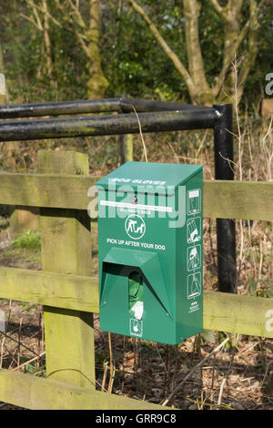Dog waste bag dispenser on the Kirkless Trail in the village of Greenmount maintained by Greenmount Village Community - Stock Image