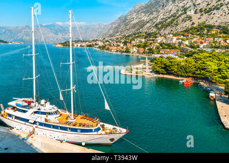 Kotor, Montenegro - September 15 2018: A sailing yacht is harbored on the Boka bay at the port of the medieval city of Kotor, Montenegro. - Stock Image