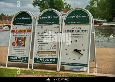 Advertising A boards for boat trips on the River Avon in Stratford upon Avon, complete with clock indicating time - Stock Image