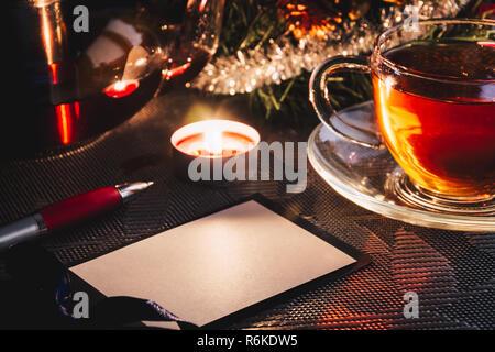 Congratulations card mockup on Christmas near cup of hot tea - Stock Image