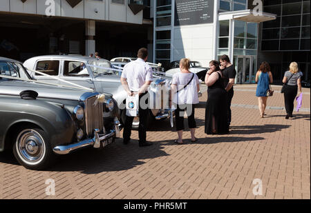 People choosing a wedding car at a Wedding Fair, Newmarket, Suffolk UK - Stock Image