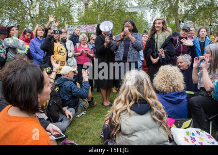 London, UK. 24th April 2019. Diane Abbott MP, Shadow Home Secretary, addresses climate change activists from Extinction Rebellion in Parliament Square - Stock Image