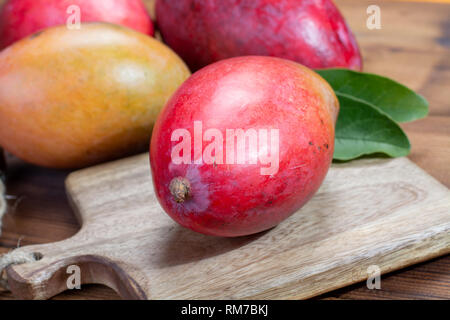 National fruit of India, Pakistan, and Philippines tropical organic ripe red mango ready to eat close up - Stock Image