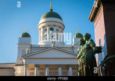 Helsinki Finland, view of the Lutheran Cathedral and statues of Nordic women sited on the Alexander ll Monument in Senate Square, Helsinki, Finland. - Stock Image
