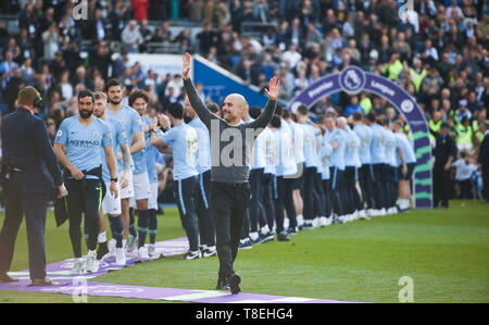 Manchester City manager Pep Guardiola celebrates winning the title during the Premier League match between Brighton & Hove Albion and Manchester City  at the American Express Community Stadium 12 May 2019 Photograph taken by Simon Dack  Editorial use only. No merchandising. For Football images FA and Premier League restrictions apply inc. no internet/mobile usage without FAPL license - for details contact Football Dataco - Stock Image
