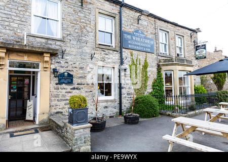 The Wheatsheaf pub Carperby, The Wheatsheaf pub sign, The Wheatsheaf pub Carperby Yorkshire UK, UK pubs, UK pub, front, exterior, sign, signs, facade - Stock Image