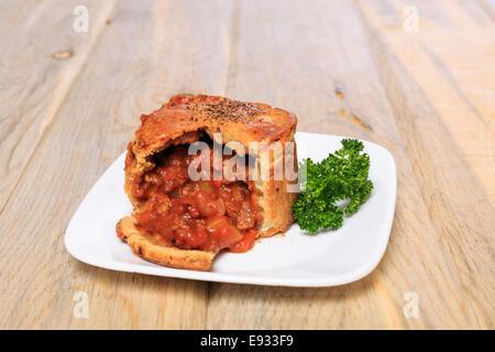 Trader Joe's Market Steak and Ale Meat Pie prepared from frozen - Stock Image