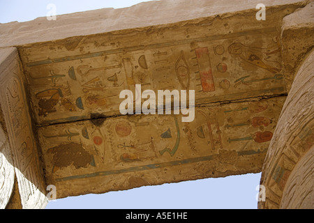 Detail of a Lintel Above Stone Columns in the Temple of Karnak, Luxor, Egypt, Decorated with Hieroglyphics and Pictures - Stock Image