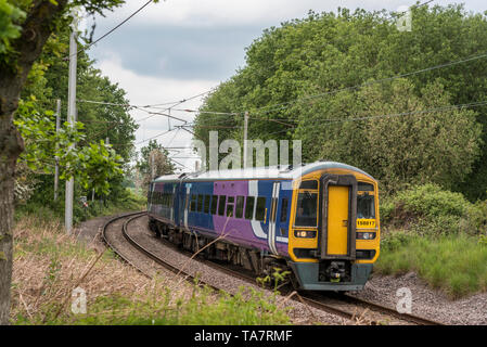 Class 158 diesel multiple unit train. Seen at Golborne junction on the West Coast Main Line. - Stock Image