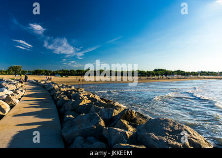 View at the beach and the seashore from a stone pier.Jesolo, Italy. - Stock Image