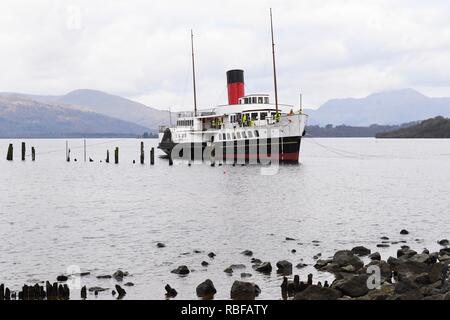Balloch, Loch Lomond, Scotland, UK - 10 January 2018: first stages of the Maid of the Loch paddle steamer being hauled out of the water as she is pulled into position.  Once on the slipway a full ultrasound survey will be carried out on the ships's hull to provide a definitive report on its current condition, before the major refurbishment takes place Credit: Kay Roxby/Alamy Live News - Stock Image