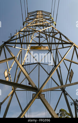 high voltage electricity tower under a blue sky - Stock Image