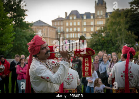 Bournemouth, UK. 29th September 2018. The Arts by the Sea Festival gets underway with all manner of colourful street performances, art, dance and music in the centre of Bournemouth. Saturday night included performances by Herbert's Dream, Silicon Shores and The Rajasthan Heritage Brass Band. Credit: Thomas Faull/Alamy Live News - Stock Image