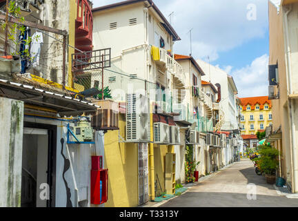 Rear of homes and many air conditioners in a laneway in Joo Chiat Singapore. - Stock Image