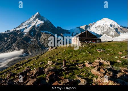 Panorama with Schoebiel SAC mountain hut with matterhorn and dent d'herens mountain peaks, Zermatt, Valais, - Stock Image