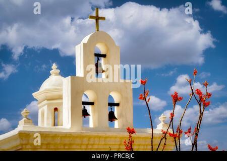 Mission San Xavier del Bac chapel with ocotillo blooming. Arizona - Stock Image