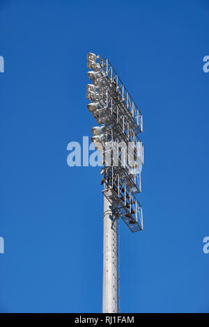 Tall sport stadium light stanchion or light tower from low angle in bright sunshine or daytime, in Montgomery Alabama, USA at River Walk Stadium. - Stock Image