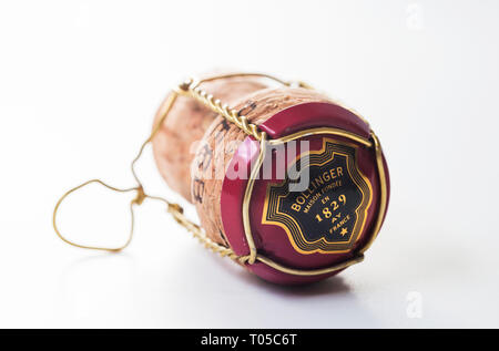 Bollinger Champagne cork, wire and foil on a white background - Stock Image