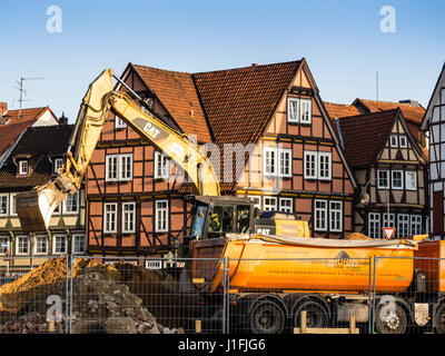 Excavator fills a truck with debris, left after tear down of the old fire station, historic downtown Celle, Lower - Stock Image