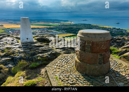The trig point and toposcope (viewpoint indicator) on the summit of North Berwick Law, East Lothian, Scotland, UK - Stock Image
