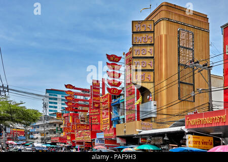 Gold shops and colourful traditional red advertising signs for easy identification. Pattaya High street Thailand Southeast Asia - Stock Image