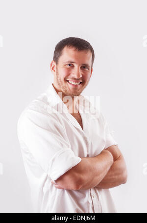 Man in white shirt over white background - Stock Image
