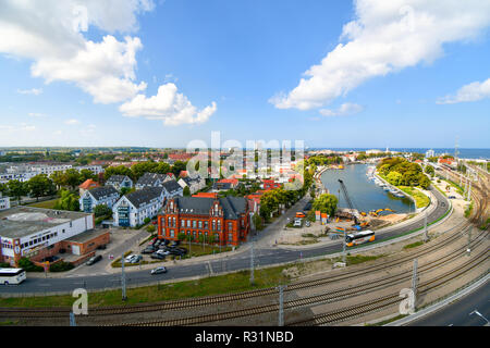 View of the Alter Strom canal, railway station and old town in the coastal port city of Warnemunde, Germany on the Baltic Sea. - Stock Image