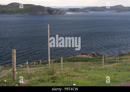 A view looking over the sea from Polbain, Scotland, to the Summer Isles from the field of a croft - Stock Image