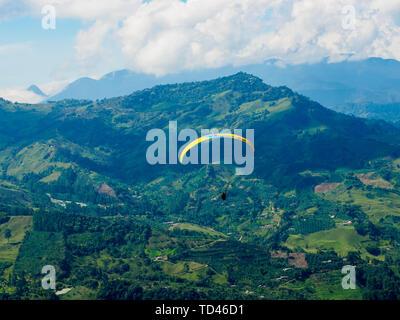 Paraglider soars near Jardin, Antioquia, Colombia, South America - Stock Image