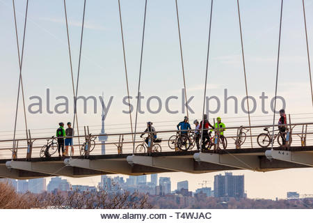 Humber Bay Arch Bridge cyclists on the Martin Goodman Trail on the western waterfront of Lake Ontario in Toronto Ontario Canada - Stock Image