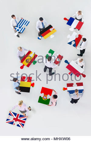 Overhead View Of Business People Holding European Flag Jigsaw To Illustrate Brexit - Stock Image