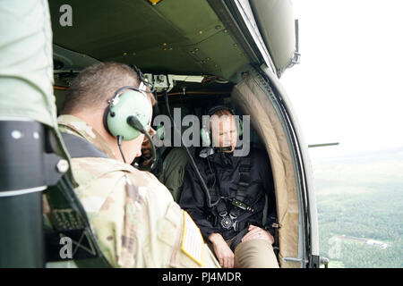 FEMA Administrator Brock Long aboard a Hawaii Army National Guard UH-60 Blackhawk during an aerial survey of areas of the island effected by the recent eruption and hurricane Lane. August 29 2018, Hilo Hawaii. The Hawaii Army National Guard provided key leadership from the Hawaii County, FEMA, USGS, and the Hawaii National Guard with an aerial survey of areas of the island effected by the recent eruption and hurricane Lane.(U.S Air National Guard Photo by Tech. Sgt. Andrew Jackson) - Stock Image