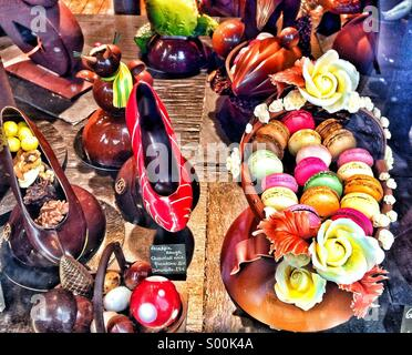Window display of chocolates in Central Paris, France. - Stock Image