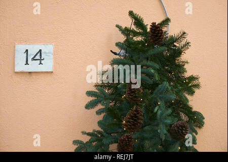 Christmas tree and house number - Stock Image