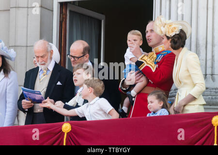 5 year old Prince George of Cambridge grabs the RAF flypast booklet from Prince Michael of Kent's hands.Buckingham Palace Balcony, Trooping the Colour - Stock Image