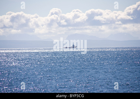 Distant ship and the Isle of Skye from the Minch, Scotland - Stock Image