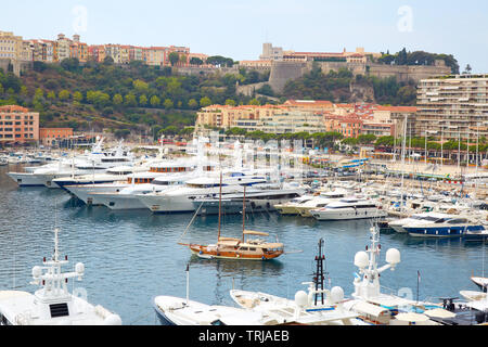 MONTE CARLO, MONACO - AUGUST 20, 2016: Monte Carlo harbor view with boats and luxury yachts in a summer day in Monte Carlo, Monaco. - Stock Image