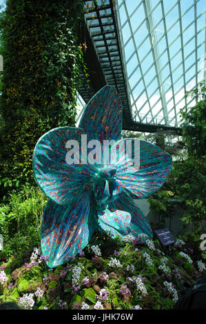 Huge Orchid sculpture, ',The Rush of Nature', by Marc Quinn. Cloud Forest, Gardens by the Bay, Singapore - Stock Image