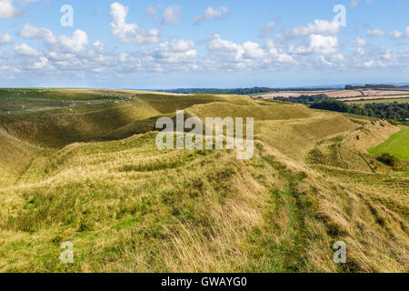 Ditches and ramparts on north side of Maiden Castle - Stock Image