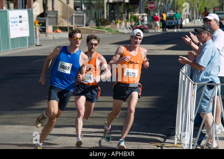 Elite racers at the 25th annual Cherry Creek Sneak 8K run in the Cherry Creek shopping district of Denver Colorado - Stock Image