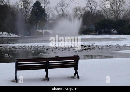 Victoria Park in snow, Hackney, London, United Kingdom - Stock Image