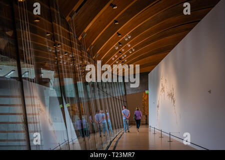 two visitors inside crystal bridge museum, found by alice walton, daughter of walmart founder sam walton - Stock Image