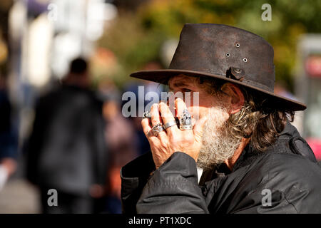 Dundee, Tayside, Scotland, UK. 5th October, 2018. Former X Factor 2017 audition contestant 'Fast Eddie' Lafferty is the harmonica playing busker and well known face on the streets of Dundee, Scotland. Eddie Lafferty has been playing the harmonica since he was 7 years old, nearly 50 years. This is Fast Eddie performing today and the streets are his stage. Credits: Dundee Photographics / Alamy Live News - Stock Image