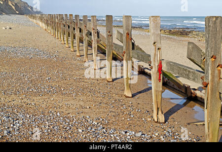 Deteriorating and eroding sea defences on the North Norfolk coast at West Runton, Norfolk, England, United Kingdom, Europe. - Stock Image
