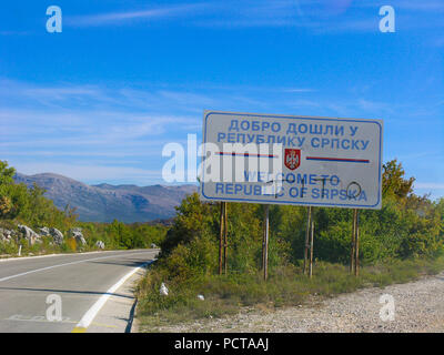 Border of Federation of Bosnia and Herzegovina and Republic of Srpska with Tito graffiti - Stock Image