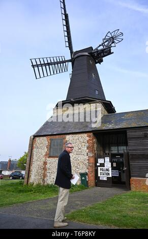 Brighton UK 2nd May 2019 - An early voter in the Hove Constituency of Hangleton & Knoll Ward outside the Polling Station at West Blatchington Windmill in Brighton and Hove this morning. Credit: Simon Dack / Alamy Live News - Stock Image