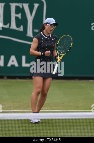 Eastbourne, UK. 24 June 2019 China's Zheng Saisai in action during her match against Marketa Vondrousova of the Czech Republic on Day three of the Nature Valley International at Devonshire Park. Credit: James Boardman / Alamy Live News - Stock Image