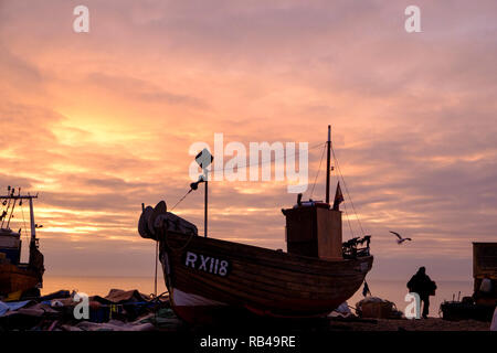 Hastings, East Sussex, UK. 7th Jan 2019. Very mild start to the day at sunrise on the Stade Fishermen's beach as fishermen start loading their boats. Hastings has the largest beach-launched fishing fleets in Europe. - Stock Image