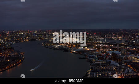 Beautiful London Riverside Skyline and Cityscape Aerial Night View feat. River Thames, The O2 Arena - Millennium Dome is large entertainment district  - Stock Image